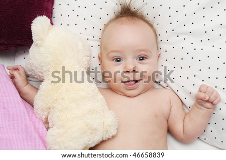 Happy baby with a teddy bear