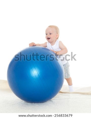 Happy baby with big blue fitness ball on a white background. Healthy lifestyle. - stock photo