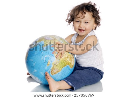 Happy baby with globe,isolated on a white background. - stock photo