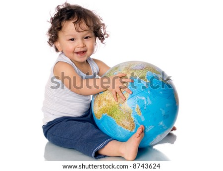 Happy baby with globe,isolated on a white background.
