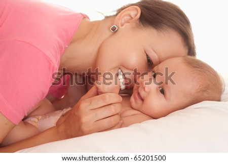 happy baby with her mother on the white
