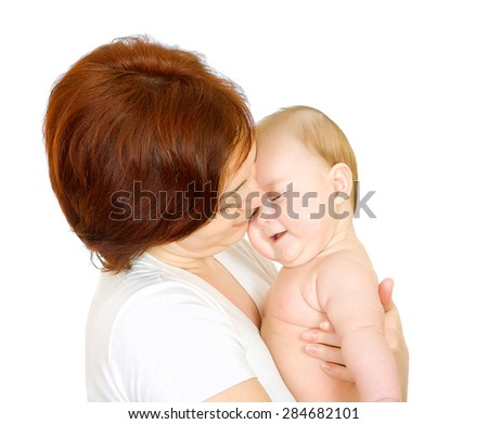 Happy baby with mother - stock photo