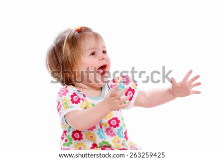 Happy baby with the arms raised - stock photo