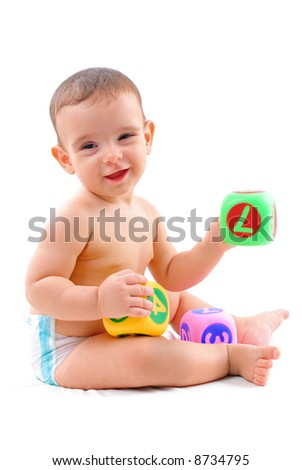 Happy Baby with toys on white background .