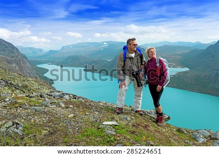 Happy backpackers at Besseggen ridge at Jotunheimen national park, Norway - stock photo