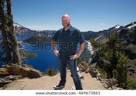 Happy bald man at Crater Lake Oregon
