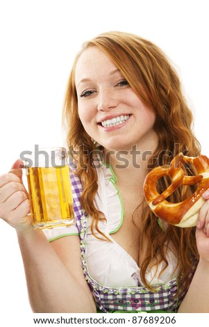 happy bavarian dressed girl with beer and pretzel on white background - stock photo