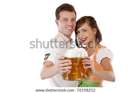 Happy Bavarian man and woman in dirndl with oktoberfest beer stein. Isolated on white background. - stock photo