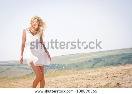 Happy beautiful and sexy young blond woman - stock photo
