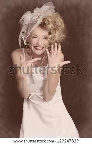 Happy Beautiful Bride showing off her ring pointing to it Vintage retro style - stock photo