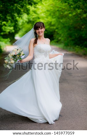 Happy beautiful bride with wedding makeup and hairstyle in bridal day smiling and waiting for groom. Attractive newlywed woman have final preparation for wedding. Gorgeous bride. Happy rich bride - stock photo