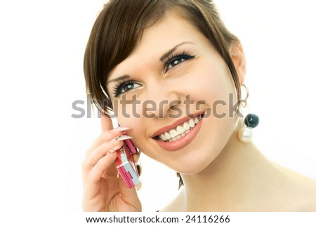 happy beautiful brunette girl talking on the cell-phone and smiling - stock photo