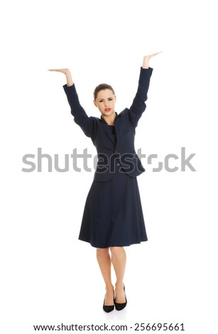 Happy beautiful business woman dancing - stock photo