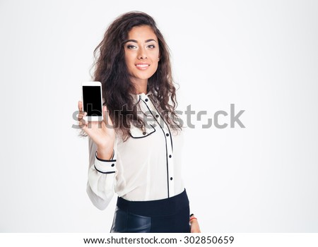 Happy beautiful businesswoman showing blank smartphone screen isolated on a white background