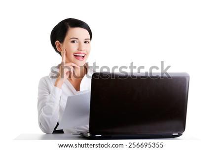 Happy beautiful businesswoman using laptop - stock photo