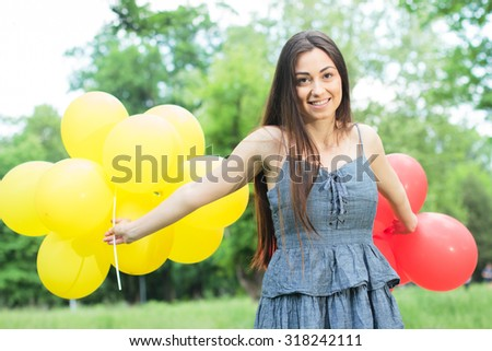 Happy, Beautiful, Carefree , Freedom Young Woman with Red and Yellow Balloons. Attractive caucasian female enjoying nature. - stock photo