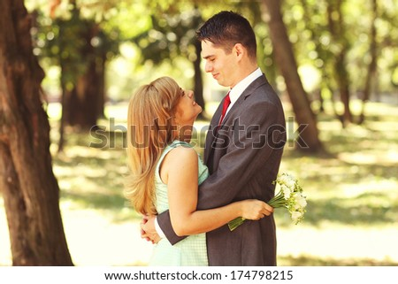 Happy beautiful couple celebrating - stock photo