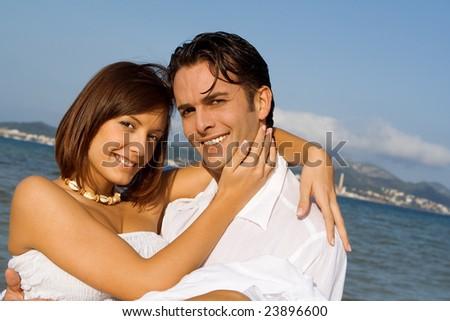 happy beautiful couple celebrating - stock photo
