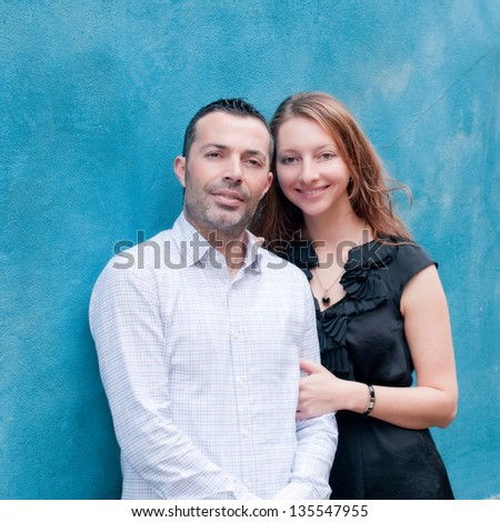 Happy beautiful couple in the small italian city - stock photo