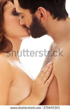 Happy beautiful couple kissing.