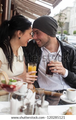 Happy Beautiful couple relaxing on the open air - stock photo