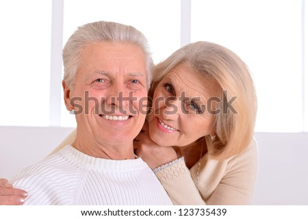 Happy beautiful elderly couple relaxing at home - stock photo