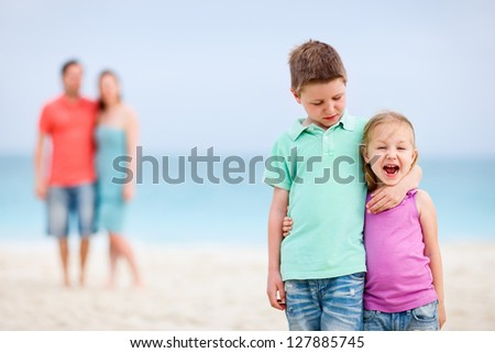 Happy beautiful family at tropical beach