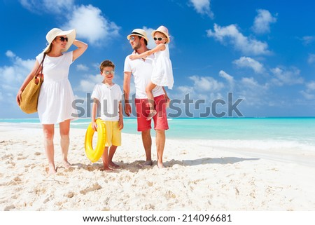 Happy beautiful family of four outdoor summer portrait - stock photo