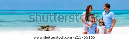 Happy beautiful family on a beach during tropical vacation - stock photo