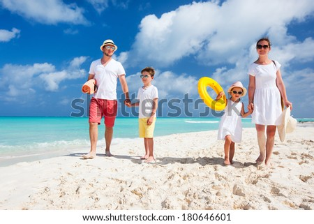 Happy beautiful family on a tropical beach vacation - stock photo