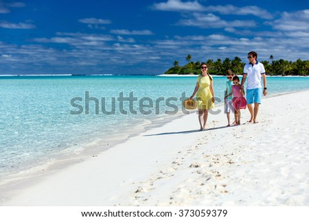 Happy beautiful family on a tropical beach vacation at exotic island in South Pacific
