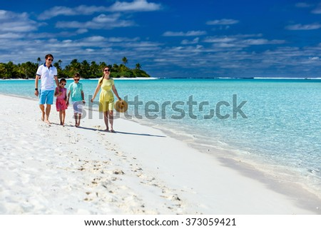 Happy beautiful family on a tropical beach vacation at exotic island in South Pacific - stock photo