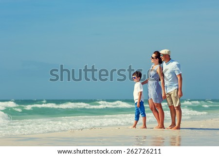 Happy beautiful family on Florida summer holiday vacation - stock photo