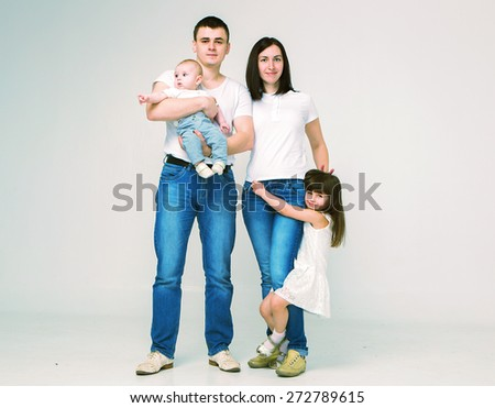 Happy beautiful family 4 people  parents sister brother portrait - stock photo