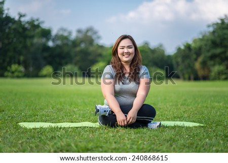 happy beautiful fat woman has relax in the garden - stock photo
