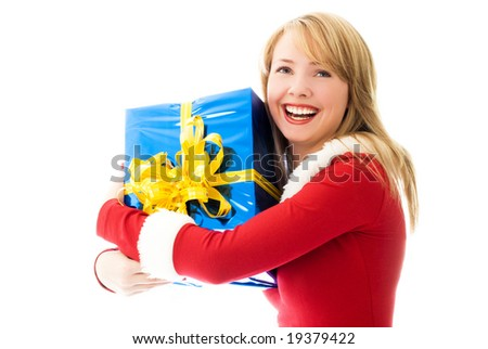 happy beautiful girl dressed as Santa with a Christmas present - stock photo