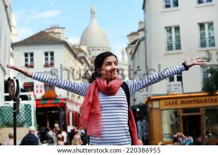 Happy beautiful girl on Montmartre in Paris - stock photo