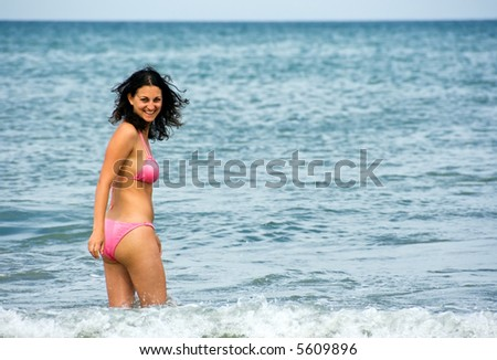 Happy beautiful girl standing in the Adriatic sea