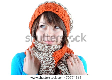 happy beautiful girl wearing a hat and scarf isolated against white background - stock photo