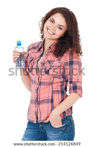 Happy beautiful girl with bottle of water on white background - stock photo