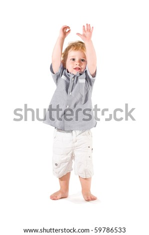 Happy beautiful little kid raising arms to celebrate isolated on white background - stock photo