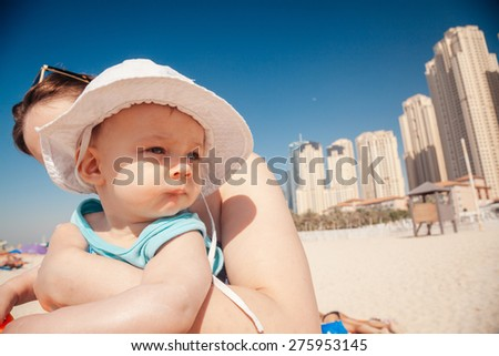 Happy Beautiful Mother And Son Enjoying At JBR Beach In Dubai Marina - stock photo