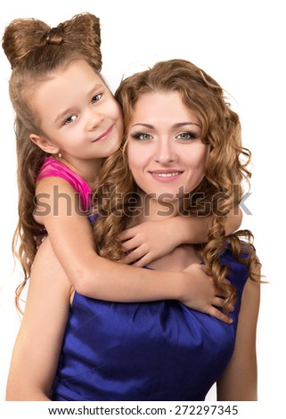 Happy beautiful mother with little daughter hugging and smiling. Isolated on white. Mothers day. People, happiness, love, family and motherhood concept. - stock photo