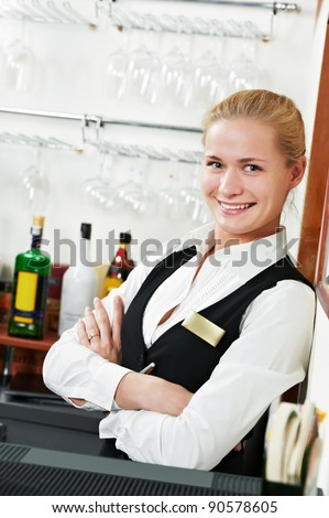 Happy beautiful restaurant manager barman administrator at work place - stock photo
