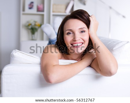 Happy beautiful smiling woman having resting at home - indoors - stock photo