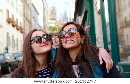 Happy beautiful student girls in Paris on the street - stock photo