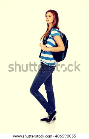 Happy beautiful teen woman with backpack - stock photo