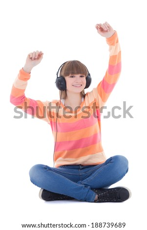 happy beautiful teenage girl listening music in headphones isolated on white background