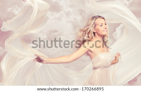 Happy beautiful woman carefree dancing with flying fabric - stock photo