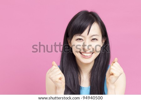 happy beautiful woman cheering - stock photo